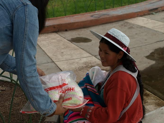 A happy mother receiving a layette in Bolivia.